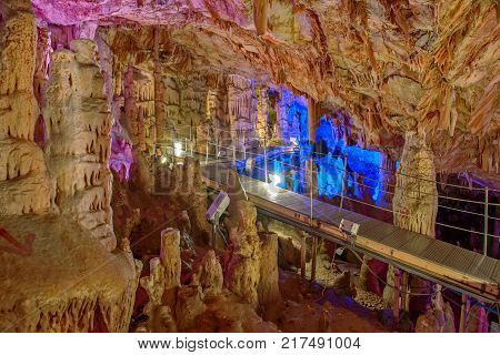 Sfendoni or Zoniana cave on Crete with colorful illumination Greece