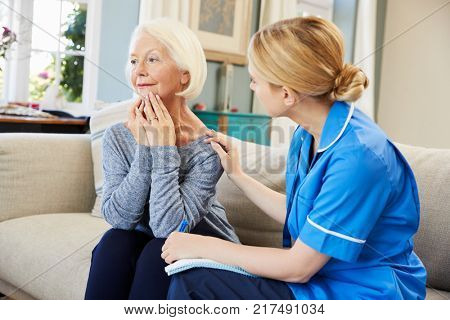 Community Nurse Visits Senior Woman Suffering With Depression