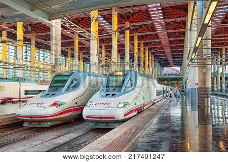 Modern Hi-speed Passenger Train Of Spanish Railways Company-renfe, On Madrid Railways Station Puerta