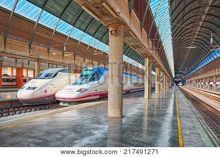 Modern Hi-speed Passenger Train Of Spanish Railways Company-renfe, On Seville Railways Station Sevil