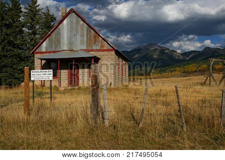 Old County School House sits in an isolated location in Colorado Rocky Mountain range