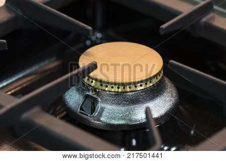 Burners metal gas hob surface plates are shot close-up