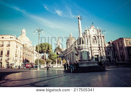 CATANIA ITALY - NOVEMBER 28 2017: Piazza del Duomo in Catania with the Cathedral of Santa Agatha in Catania in Sicily Italy.