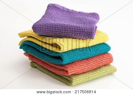 Stack Of Neatly Folded Colorful Kitchen Towels, On White Background.