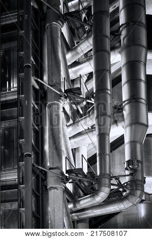 London, UK, January 12, 2012 : Detail of the Lloyd's Building at night which is the headquarters of the insurance firm Lloyd's of London in heart of the city's financial district monochrome image