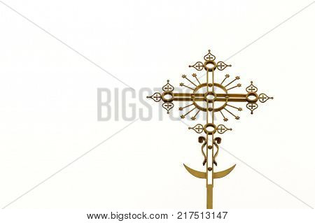 Yellow Orthodox, Christian or Catholic cross with a crescent at the bottom.