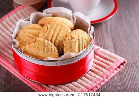 Peanut butter cookies in a tin on table