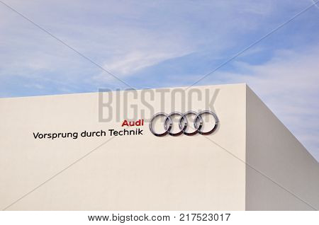 FRANKFURT - SEPTEMBER 21: Audi trademark and slogan on white building at the 65th Internationale Automobil Ausstellung (IAA) on September 21 2013 in Frankfurt Germany.