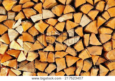 Stack of dry firewood for background or texture.