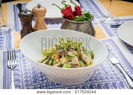 Cesar salad with roasted chicken meat, traditional Georgian cuisine