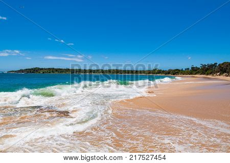 Picturesque tropical beach with sand and waves. Summer vacation getaway nature background. Bundeena Australia