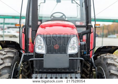 Equipment for agriculture, machines  presented to an agricultural exhibition.  Tractors outdoors.