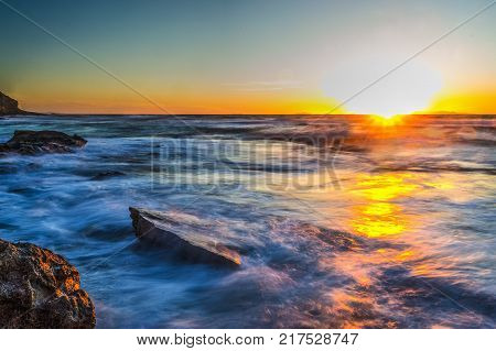 Sunset in Sardinia coastline with motion blur effect