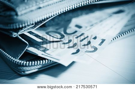 Euro banknotes in wallet. business finance investment saving and cash concept - close up of euro paper money
