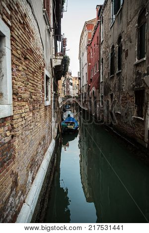 Beautiful photo of the Venetian canal with old houses Italy .