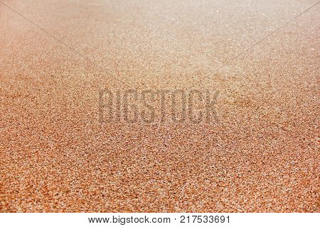 Sand Texture Background Beach Seamless Detailed Summer Theme Wallpaper. Vibrant Sandy Shore Close Up Vivid Image Top View with No People. Tropical Vacation and Summer Holiday Season Concept.