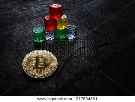 Gold bitcoin and dice in pyramid shape