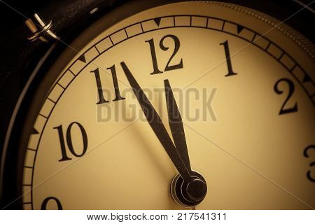 Old Grunge Vintage Alarm Clock Is Showing Midday Or Midnight Movement. It Is Twelve O'clock, Holiday