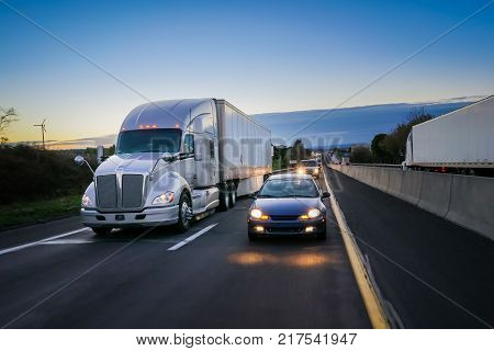 18 Wheeler Semi Truck On The Road At Dusk