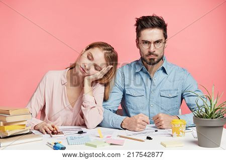 Oh, Bother! Annoyed Clever Young Male Has Much Work, Surrounded With Many Papers, Doesn`t Know How M
