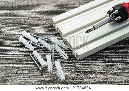 Materials needed for installing curtain cornice,dowel screws and screwdrivers,