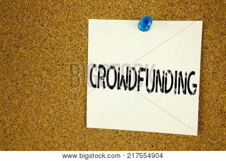 Conceptual hand writing text caption inspiration showing Crowdfunding. Business concept for  Business Fundraising Project Funding written on sticky note, reminder cork background with space