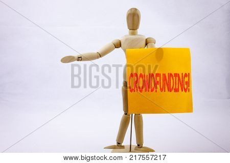 Conceptual hand writing text caption inspiration showing Crowdfunding Business concept for Business Fundraising Project Funding on sticky note sculpture background with space