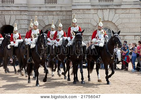 LONDON - JUNE 14: Unidentified members of The Queen's Life Guard or Horse Guard  participate in the changing ceremony in London, UK on June 14, 2011. Guard Mounting Ceremony is held daily during spring and summer.