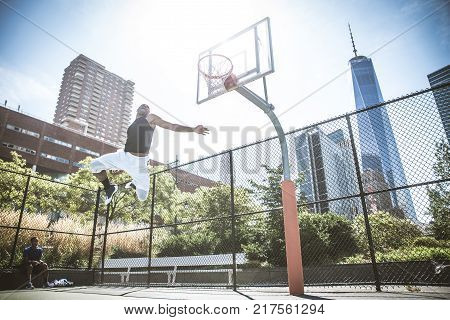 Basketball Player Playing Outdoors