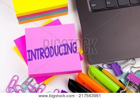 Writing text showing Introducing made in the office with surroundings such as laptop, marker, pen. Business concept for Introduction Start Intro Beginning Workshop white background space
