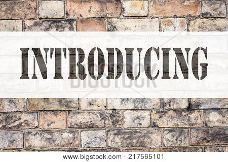 Conceptual announcement text caption inspiration showing Introducing. Business concept for Introduction Start Intro Beginning written on old brick background with space