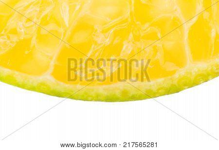 Orange slice background macro view. Part of tangerine orange slice fruits on white background. Yellow tangerine orange slice fruits isolated background.