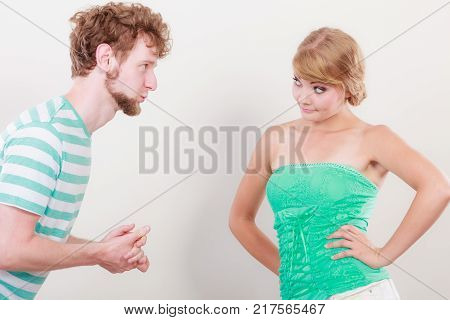 Conflicted couple. Relationship problem. Boyfriend trying to convince girlfriend. Man asking for forgivness. Husband apologizing wife. Unhappy upset angry woman refuses apology.