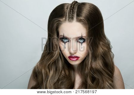 Woman with stylish fancy gothic Halloween makeup