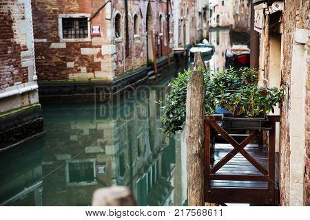 Beautiful view of the balcony with flowers and the canal. Venice Italy .