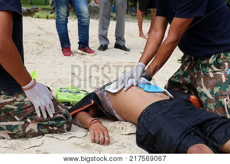 CPR and AED on the beach Training Automated External Defibrillator for Rescue and first aid in Thailand.