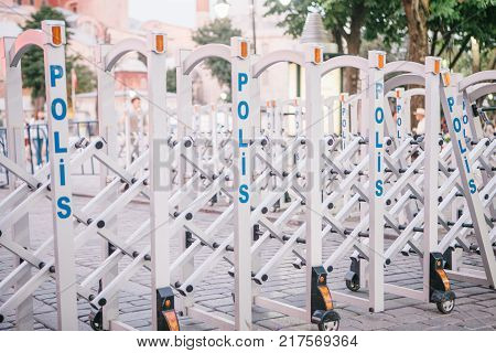 A mechanical obstacle with an inscription in Turkish meaning the police. Protection of public order, counteraction to crime, investigation of crimes