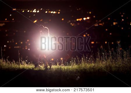 Texture with background for love: silhouette of loving couple against background of night city lights. Concept first love, feelings without boundaries, touch and flight of soul and consciousness. copyspase