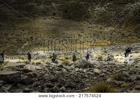 People walking Volcano Nevada de Toluca with lakes inside crater in Mexico