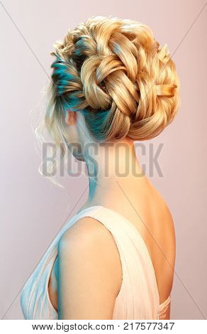 Blonde Girl with Long and shiny Curly Hair. Beautiful Model Woman with Curly Hairstyle. Care and Beauty Hair products. Care and Beauty of Hair