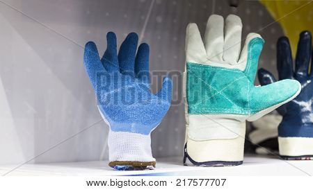 the industrial coated cotton Gloves ; selective focus