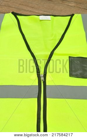 Close up of a safety jacket isolated on a wooden background