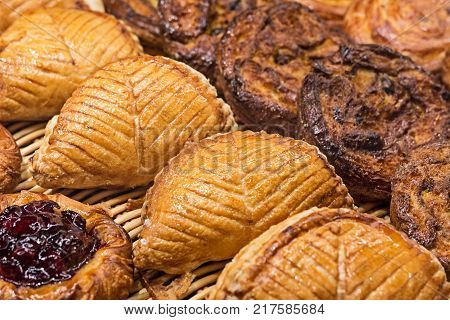 Buns of puff pastry on the shelves of French bakery