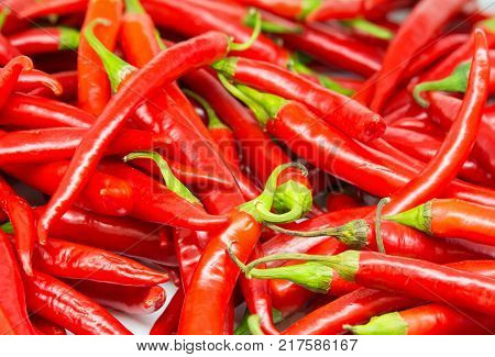 Red hot peppers with a price tag on the counter