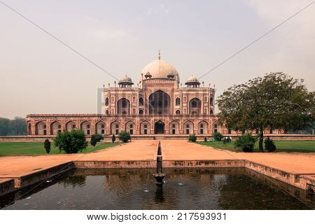 NEW DELHI INDIA - MARCH 19 2016: Wide angle picture of Isa Khan Niazi located in Humayun's Tomb Complex during a sunny day in New Delhi India.