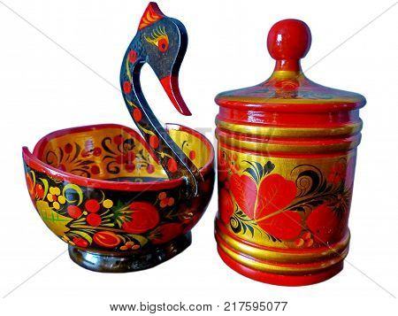 Khokhloma bucket in the form of a bird and sugar bowl on a white background. Khokhloma-an ancient Russian folk craft (XVII century). Isolated on white. Traditional elements Khokhloma-red juicy berrie.