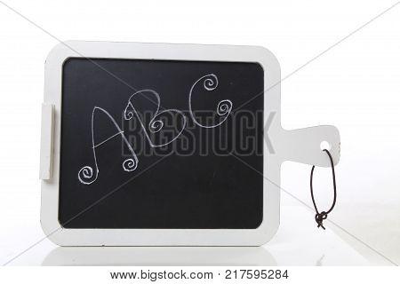 hand written ABC letters on a blackboard