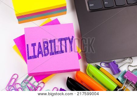 Writing text showing Liability made in the office with surroundings such as laptop, marker, pen. Business concept for Accountability Legal Blame Risk Workshop white background space