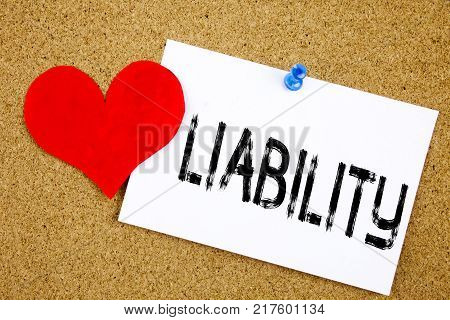 Conceptual hand writing text caption inspiration showing Liability concept for Accountability Legal Blame Risk and Love written on sticky note, reminder cork background with space