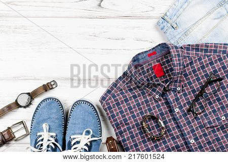Men's casual outfit. Men's fashion clothing and accessories on white wooden background, flat lay, copy space